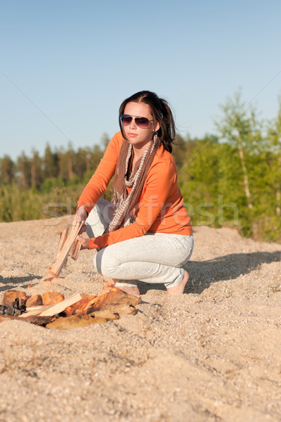 Camping happy woman making campfire on beach Stock photo © CandyboxPhoto