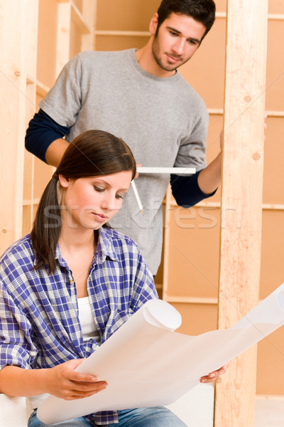 Home improvement young couple with blueprints Stock photo © CandyboxPhoto