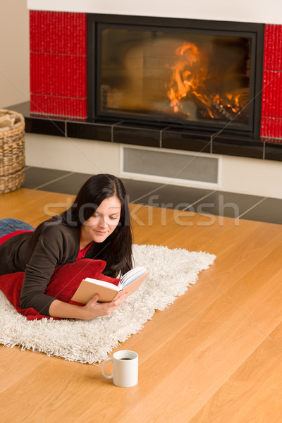 Home fireplace happy woman read book winter Stock photo © CandyboxPhoto