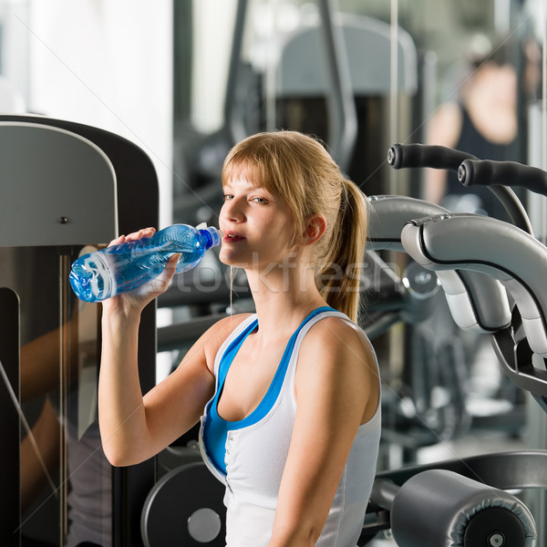 Woman drink water at fitness machine Stock photo © CandyboxPhoto