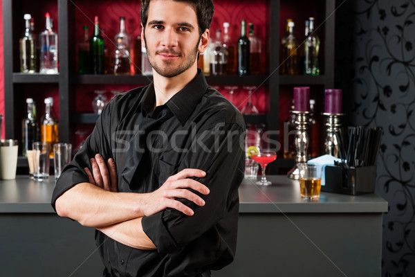 Barman in black standing at cocktail bar Stock photo © CandyboxPhoto