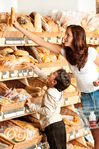 Grocery store shopping - Young woman with child Stock photo © CandyboxPhoto