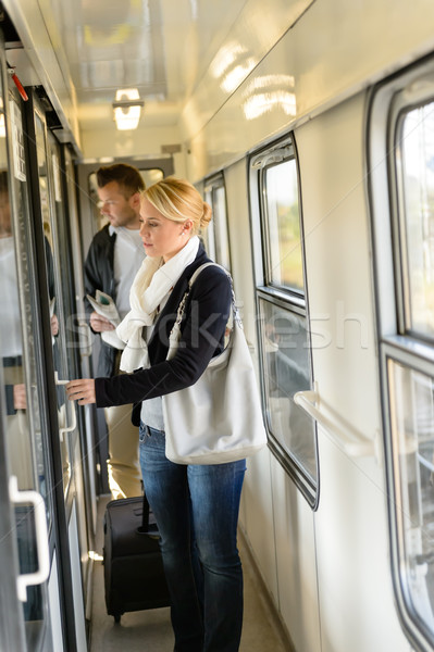 Woman opening the  door of train compartment Stock photo © CandyboxPhoto
