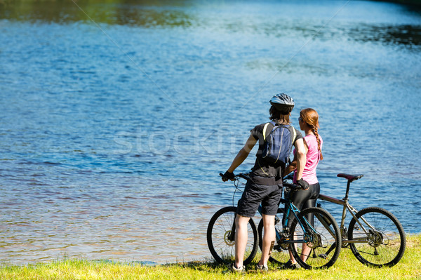 Young cyclist couple watching the lake Stock photo © CandyboxPhoto