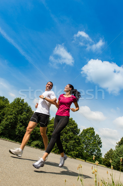 Low angle view of couple running outdoors Stock photo © CandyboxPhoto