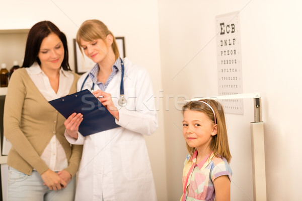 Medical check-up pediatrician girl measure height Stock photo © CandyboxPhoto