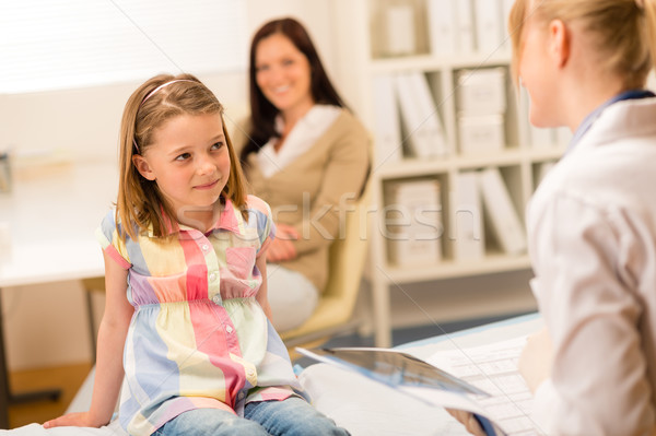 At pediatrician office girl looking at doctor Stock photo © CandyboxPhoto
