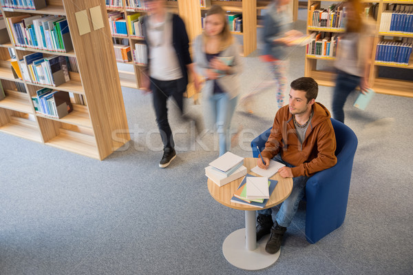 Student writing notes in library blur motion Stock photo © CandyboxPhoto
