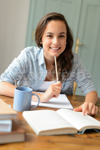 Student teenage girl studying at home smiling Stock photo © CandyboxPhoto