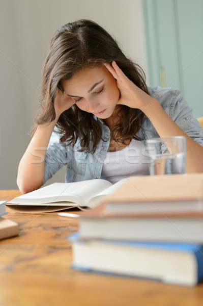Student teenage girl concentrate reading book home Stock photo © CandyboxPhoto