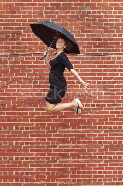 Umbrella Jump! Stock photo © cardmaverick2