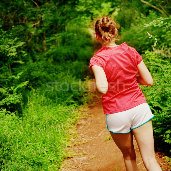 Woman In Red Running Stock photo © cardmaverick2