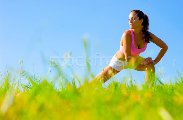 Athletic Woman Exercising  Stock photo © cardmaverick2
