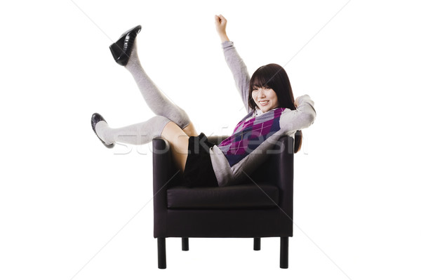 Excited Chinese student in a leather chair. Stock photo © cardmaverick2