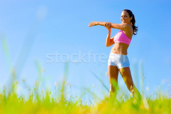 Athletic Woman Exercising  Stock photo © cardmaverick2