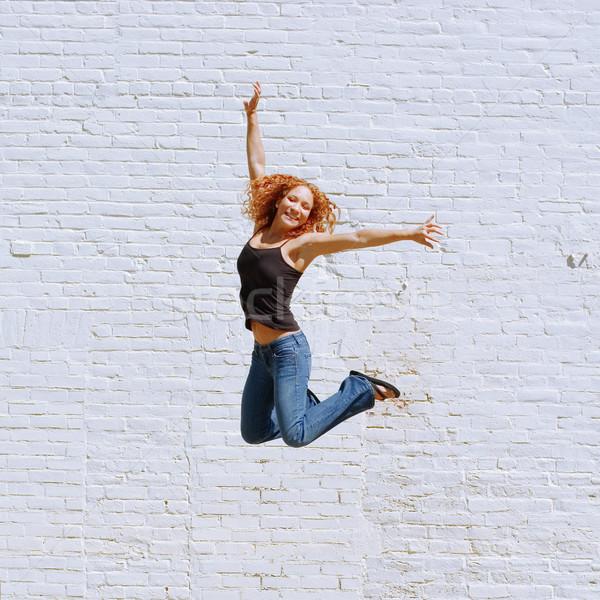 городского девушки привлекательный белый кирпичная стена женщину Сток-фото © cardmaverick2