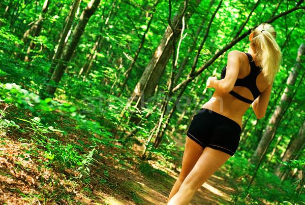 Blonde Woman Exercising  Stock photo © cardmaverick2