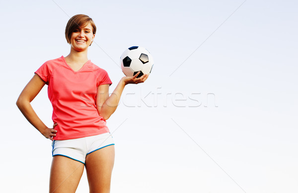 Young Woman Playing Soccer Stock photo © cardmaverick2