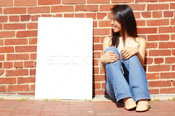 Sexy Girl With Poster Stock photo © cardmaverick2