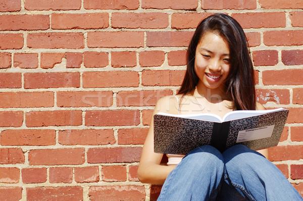 Girl Writing In Note Book Stock photo © cardmaverick2