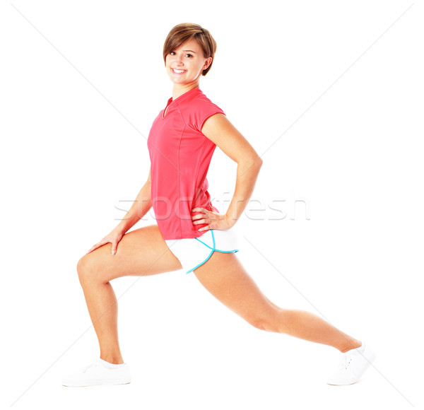 Young Fitness Woman in Red Shirt Stretching, Isolated on White Stock photo © cardmaverick2