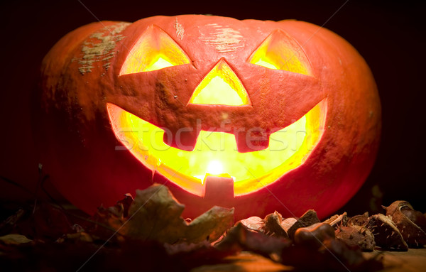 Creepy pumpkin with candle in mouth, halloween concept Stock photo © carenas1