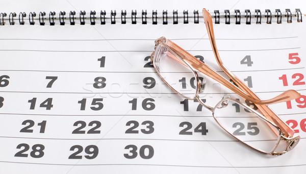 Eyeglass on calendar to schedule plans Stock photo © carenas1