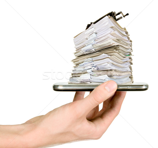 Man is showing mobile phone with documents Stock photo © carenas1