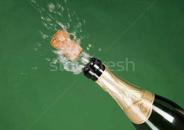 Explosion of green champagne bottle cork Stock photo © carenas1