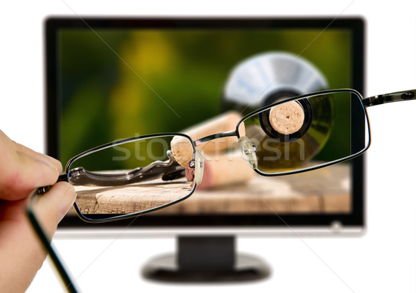 Man is viewing to wine bottle on display Stock photo © carenas1