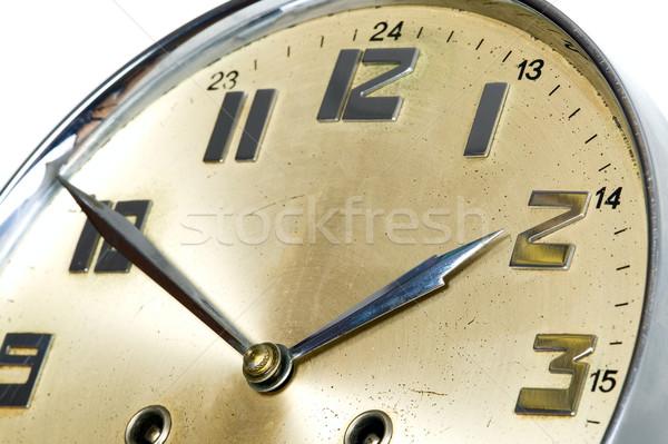 Golden clock with arrows Stock photo © carenas1