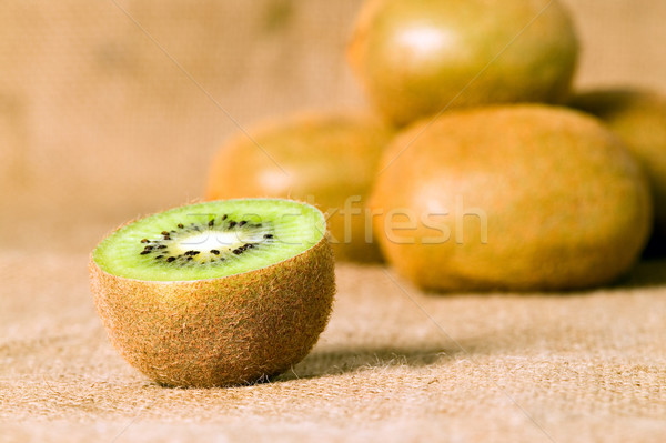 Green fruit kiwi on brown background Stock photo © carenas1