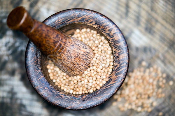 Wooden pestle with grits Stock photo © carenas1