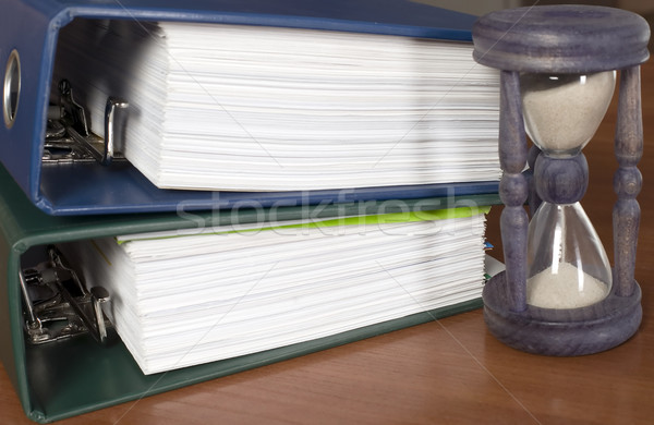 Block of documents with sand clock Stock photo © carenas1