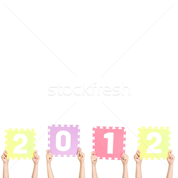 Children are holding new 2012 year Stock photo © carenas1