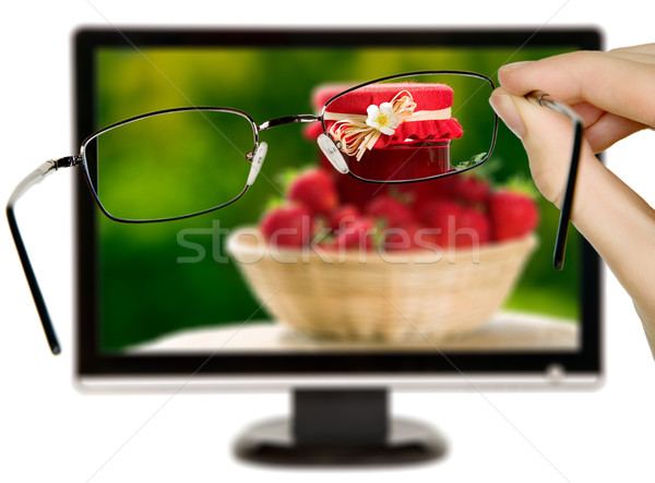 Man is viewing to strawberries on display Stock photo © carenas1