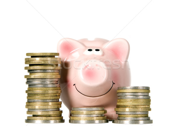 Stock photo: Pig is smiling and standing near money