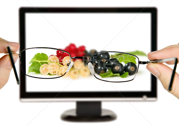 Man is viewing to currants with leaves on display Stock photo © carenas1