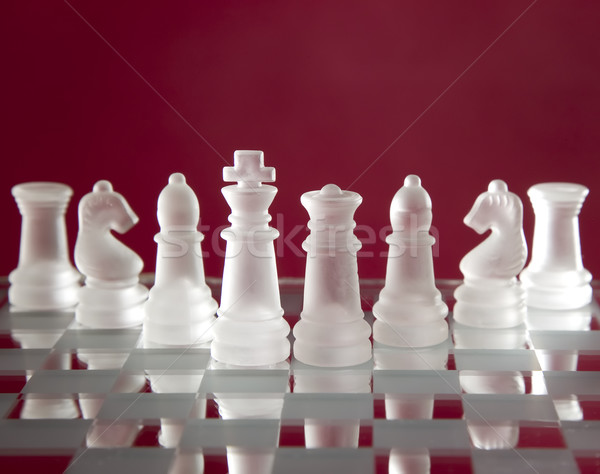 Chess game figures on red background Stock photo © carenas1
