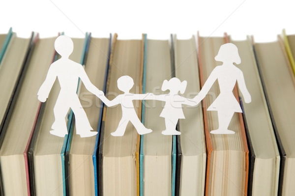 Family figures made from paper with books background Stock photo © carenas1