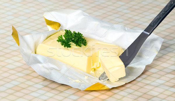 Yellow butter with paper package Stock photo © carenas1