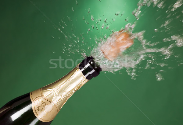 Explosion of green champagne bottle cork Stock photo © carenas1