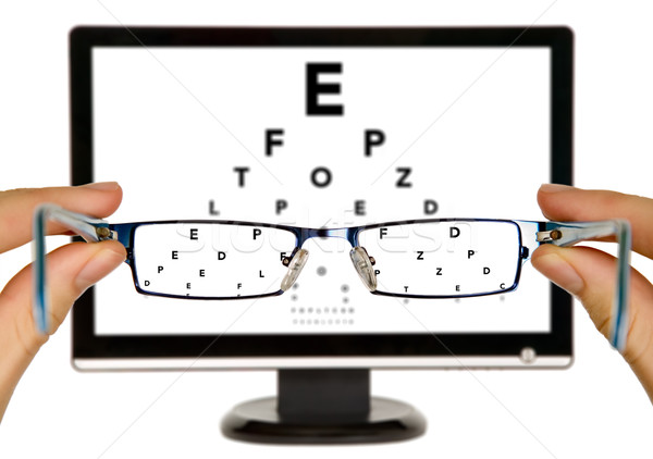 Man is viewing to eye examination chart Stock photo © carenas1
