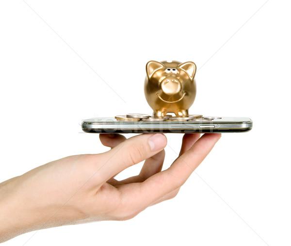 Dorado alcancía superior teléfono móvil Screen hombre Foto stock © carenas1
