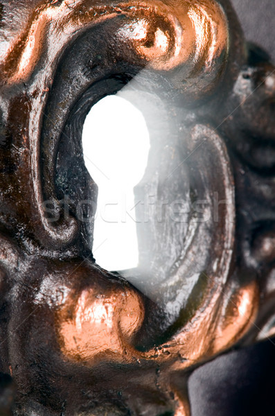 Light is coming through the hole of key Stock photo © carenas1