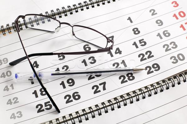 Eyeglass on calendar Stock photo © carenas1