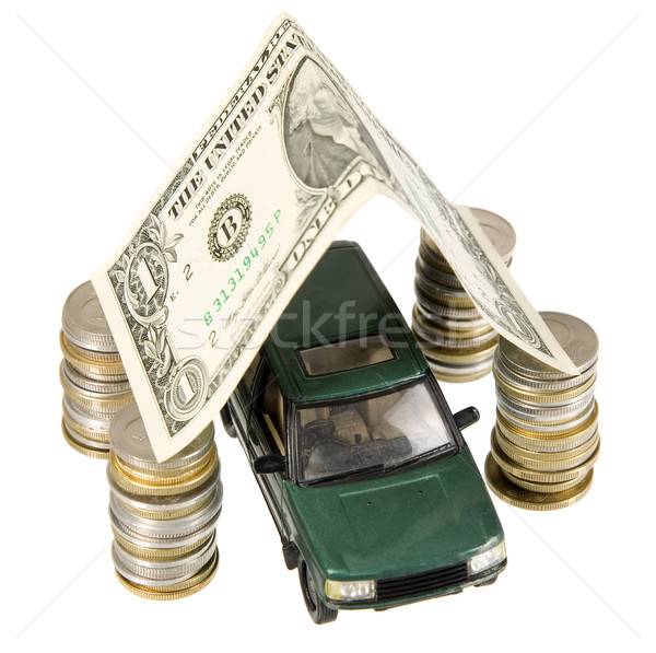 A old fashion car under garage roof made from banknote Stock photo © carenas1