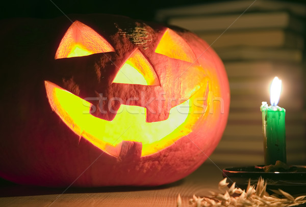 Creepy pumpkin near candle, halloween concept Stock photo © carenas1
