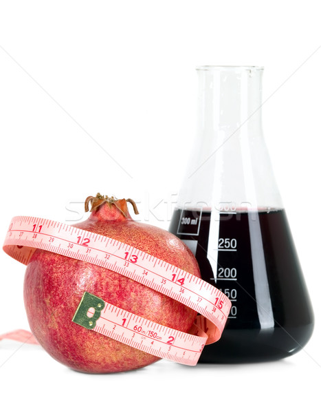 Tasteful fruit garnet with measuring tape Stock photo © carenas1
