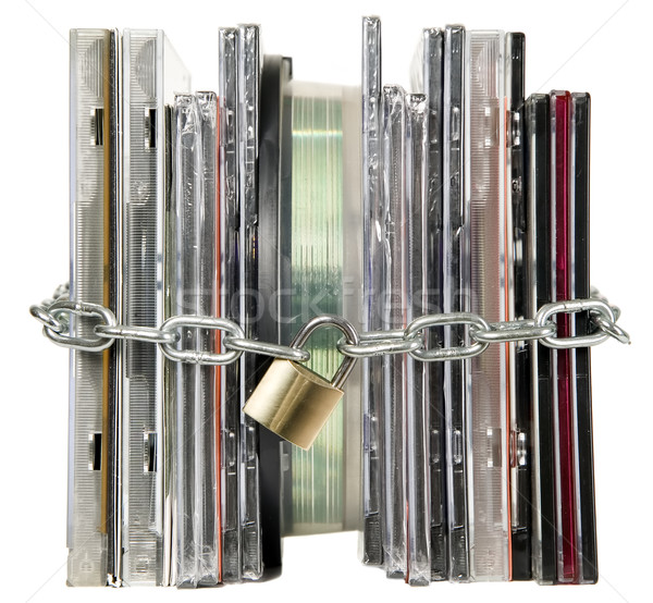 Compact discs are secured with lock Stock photo © carenas1